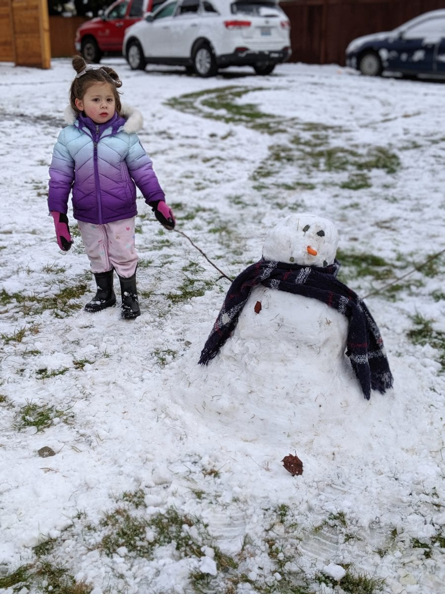 building a snowman at NCA School