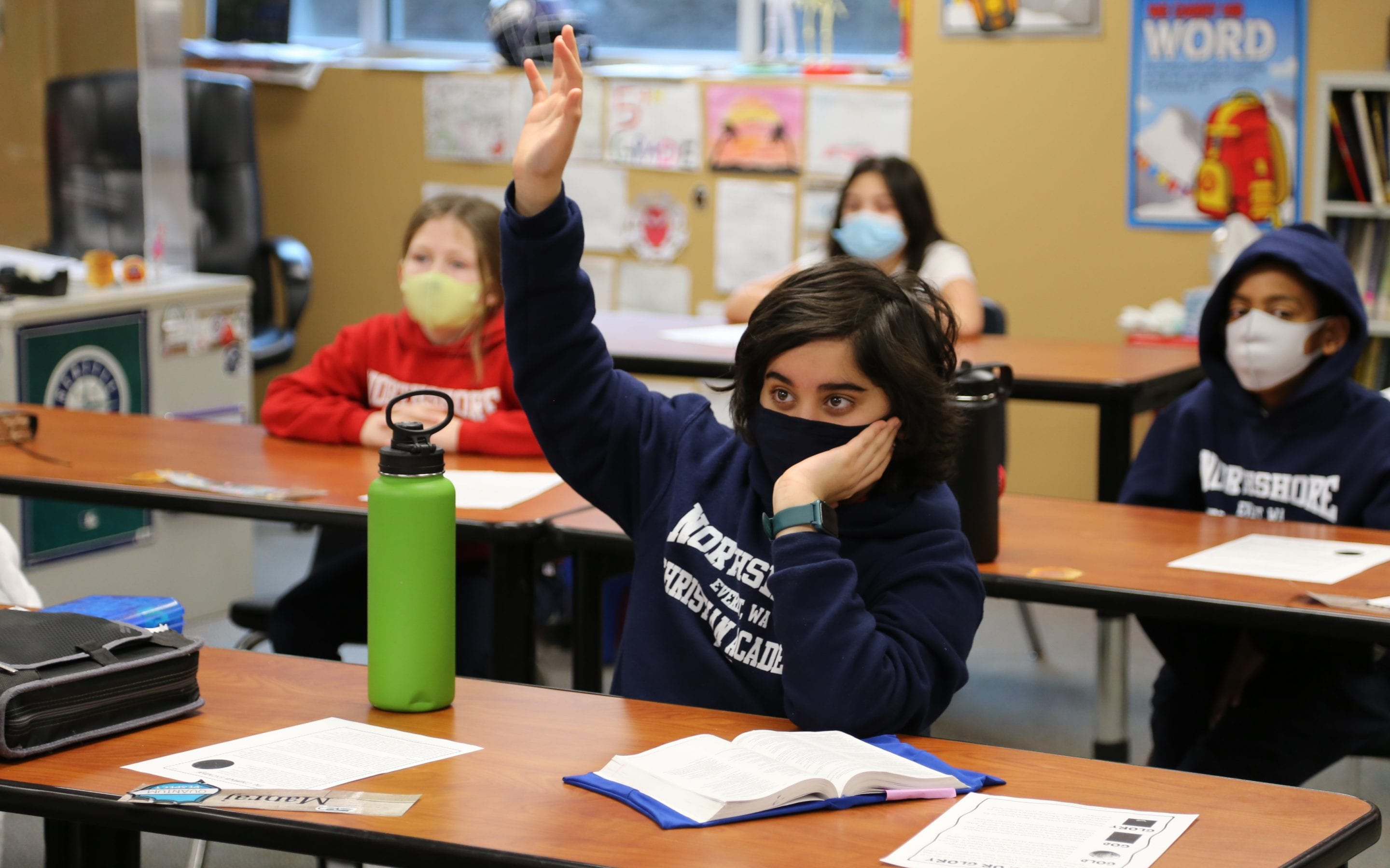 Northshore Christian Academy student wearing a mask in the classroom to slow the spread of COVID
